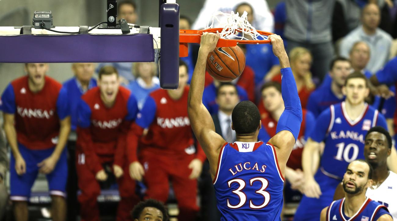 Kansas forward Landen Lucas (33) dunks as Kansas takes on TCU during the second half of an NCAA college basketball game, Saturday, Feb. 6, 2016, in Fort Worth, Texas. Kansas won 75-56. (AP Photo/Ron Jenkins)