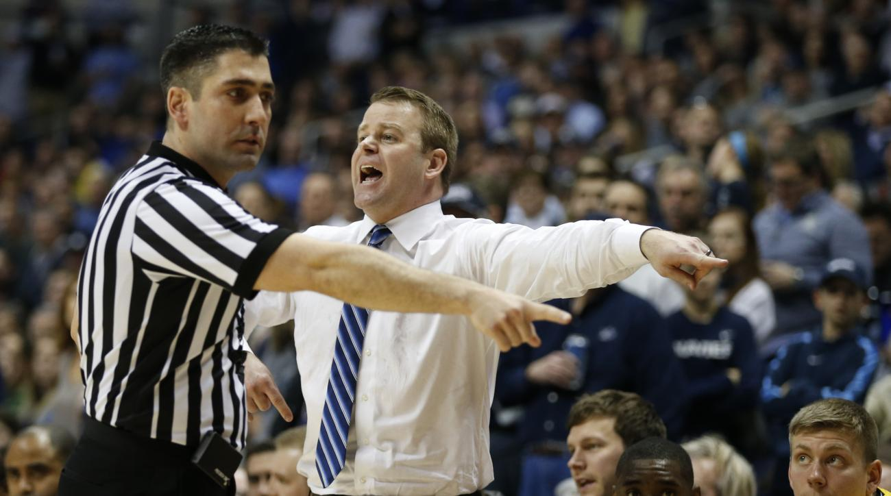 Marquette head coach Steve Wojciechowski argues a call with referee Tony Chiazza, during the second half of an NCAA college against Xavier basketball game Saturday, Feb. 6, 2016, in Cincinnati. Xavier won 90-82. (AP Photo/Gary Landers)