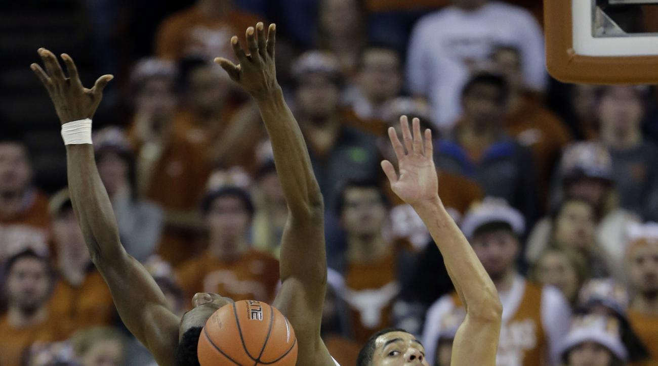 Texas guard Tevin Mack (0) is blockd by Texas Tech forward Zach Smith (11) as he drives to the basket during the first half of an NCAA college basketball game, Saturday, Feb. 6, 2016, in Austin, Texas. (AP Photo/Eric Gay)