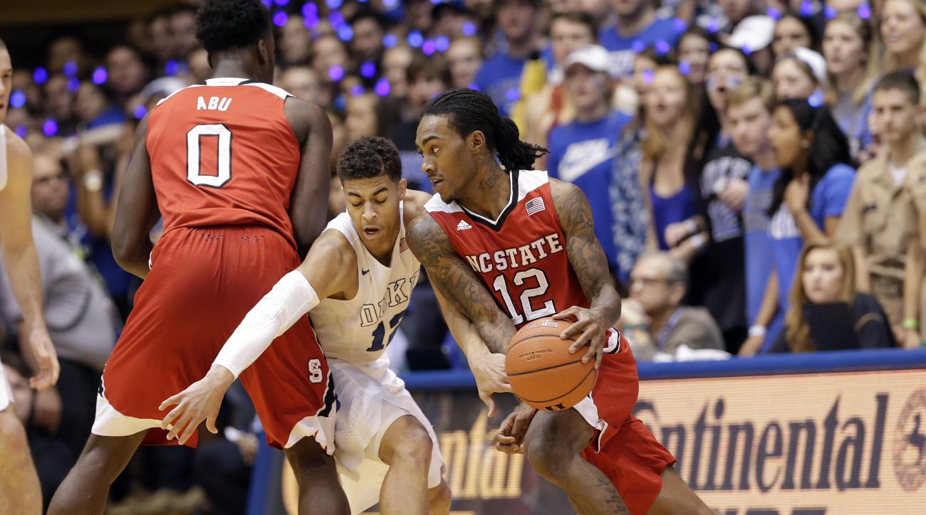 Duke's Derryck Thornton guards North Carolina State's  Anthony Barber (12) as State's Abdul-Malik Abu (0) blocks during the first half of an NCAA college basketball game in Durham, N.C., Saturday, Feb. 6, 2016. (AP Photo/Gerry Broome)