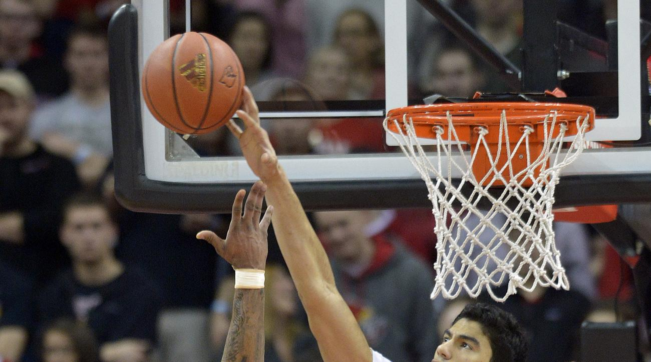 Louisville's Anas Mahmoud (14) blocks the shot of Boston College's Garland Owens (5) during the second half of an NCAA college basketball game, Saturday, Feb. 6, 2016, in Louisville Ky. Louisville won 79-47. (AP Photo/Timothy D. Easley)