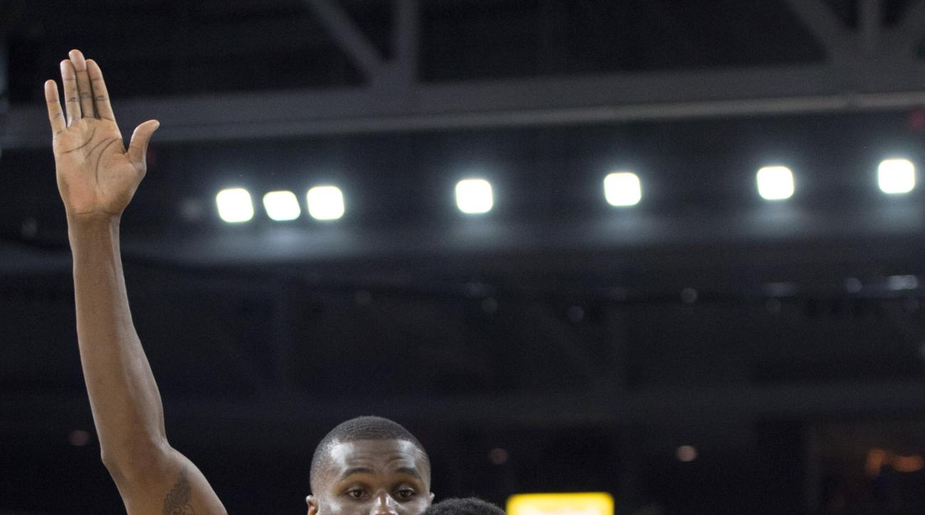Villanova forward Darryl Reynolds, right, drives past Providence forward Ben Bentil, left, during the second half of an NCAA basketball game, Saturday, Feb. 6, 2016, in Providence, R.I.  Villanova beat Providence 72-60. (AP Photo/Gretchen Ertl)