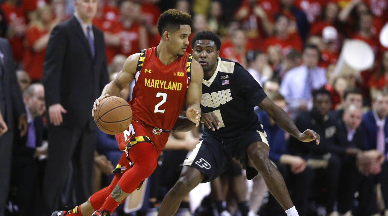Maryland guard Melo Trimble (2) drives around Purdue guard Johnny Hill during the first half of an NCAA college basketball game, Saturday, Feb. 6, 2016, in College Park, Md. (AP Photo/Patrick Semansky)