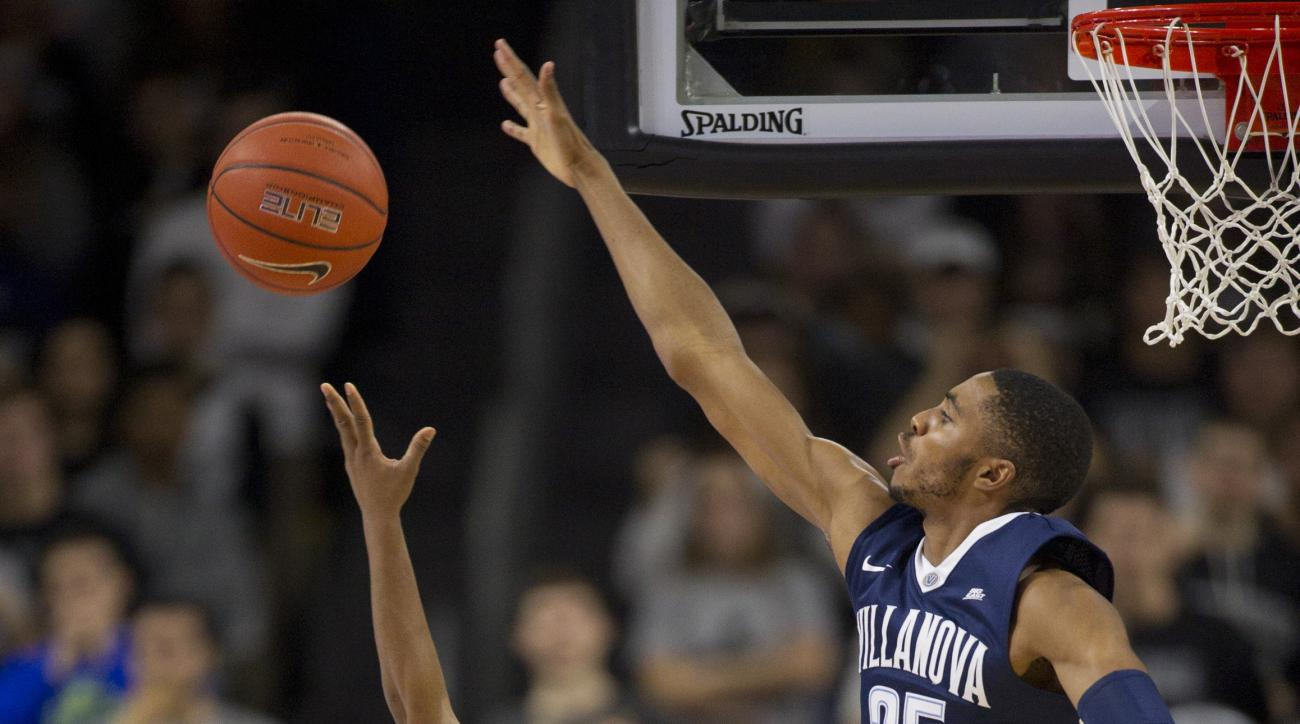 Villanova guard Mikal Bridges (25) blocks a shot-attempt by Providence guard Kyron Cartwright (24) during the second half of an NCAA basketball game, Saturday, Feb. 6, 2016, in Providence, R.I. (AP Photo/Gretchen Ertl)