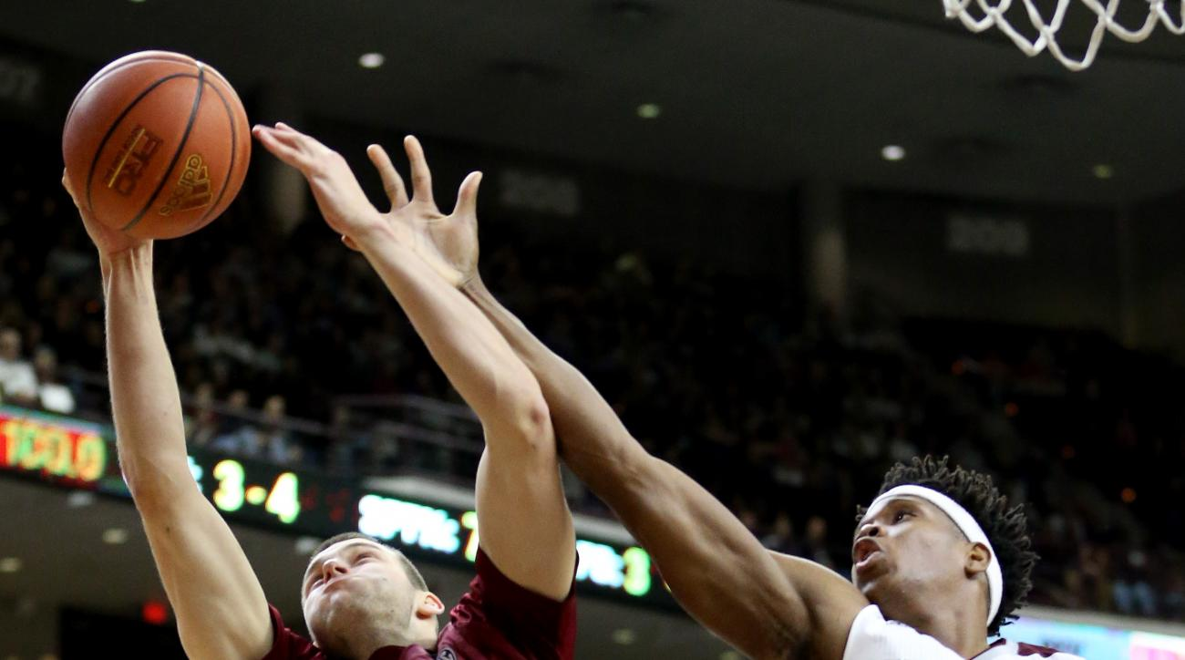 South Carolina's Laimonas Chatkevicius (14) rebounds a ball against Texas A&M's Tavario Miller (14) during the first half of an NCAA college basketball game, Saturday, Feb. 6, 2016, in College Station, Texas. (AP Photo/Sam Craft)