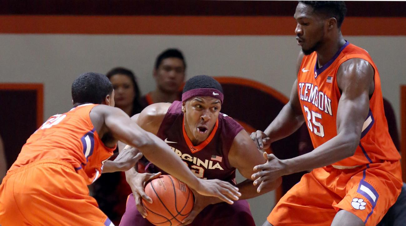 Virginia Tech's Zach LeDay (32) is surrounded by Clemson defenders Donte Grantham (15) and Landry Nnoko (35) during the first half of an NCAA college basketball game in Blacksburg Va., Saturday, Feb. 6 2016. (Matt Gentry /The Roanoke Times via AP) LOCAL T