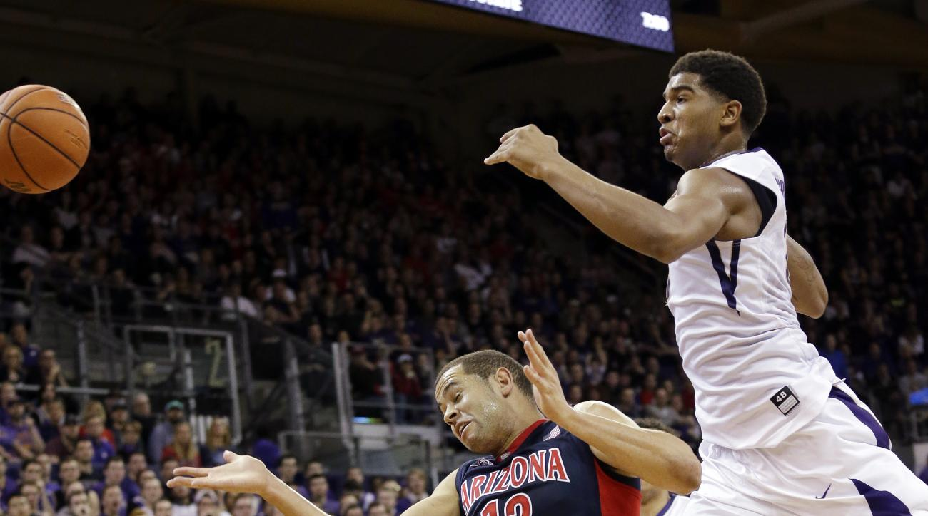 Washington's Marquese Chriss, right, collides with Arizona's Ryan Anderson (12) as the ball flies out of bounds during the first half of an NCAA college basketball game Saturday, Feb. 6, 2016, in Seattle. (AP Photo/Elaine Thompson)