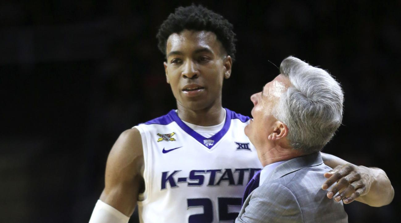 Kansas State head coach Bruce Weber, right, hugs forward Wesley Iwundu (25) during the second half of an NCAA college basketball game against Oklahoma at Bramlage Coliseum in Manhattan, Kan., Saturday, Feb. 6, 2016. Iwundu scored 22 points in the game. Ka