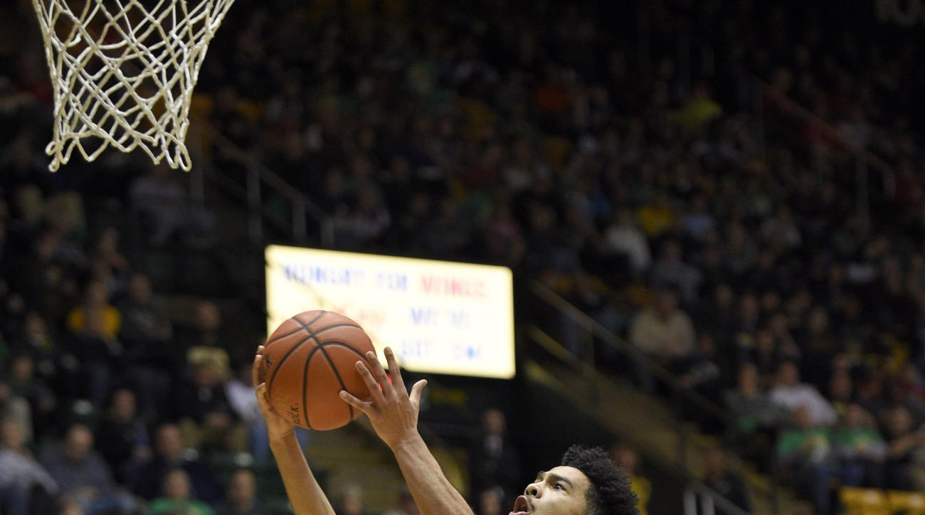 George Mason guard Otis Livingston II (4) goes to the basket against Dayton guard Scoochie Smith (11) and Charles Cooke, back left, during the second half of an NCAA college basketball game, Saturday, Feb. 6, 2016, in Fairfax, Va. Dayton won 98-64. (AP Ph