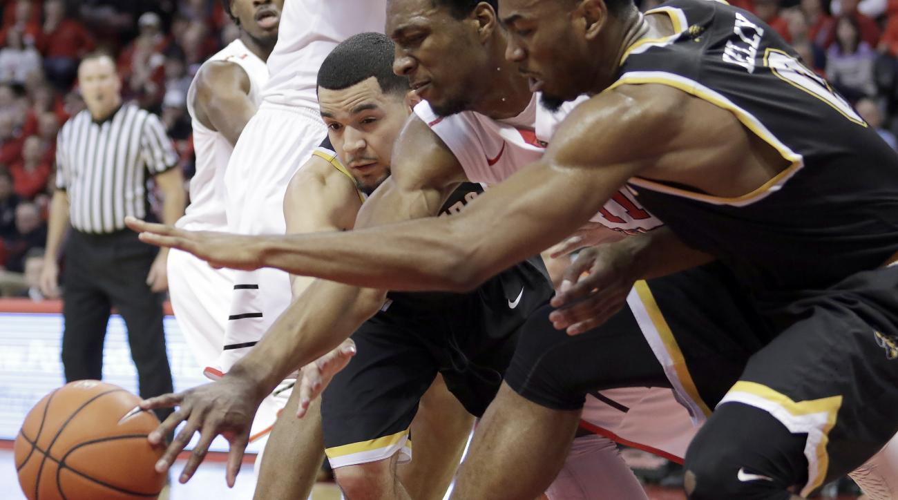 Wichita State guard Fred VanVleet, left, and forward Rashard Kelly, right, and Illinois State forward MiKyle McIntosh (11) reach for a rebound during the first half of an NCAA college basketball game Saturday, Feb. 6, 2016, in Normal, Ill. (AP Photo/Steph