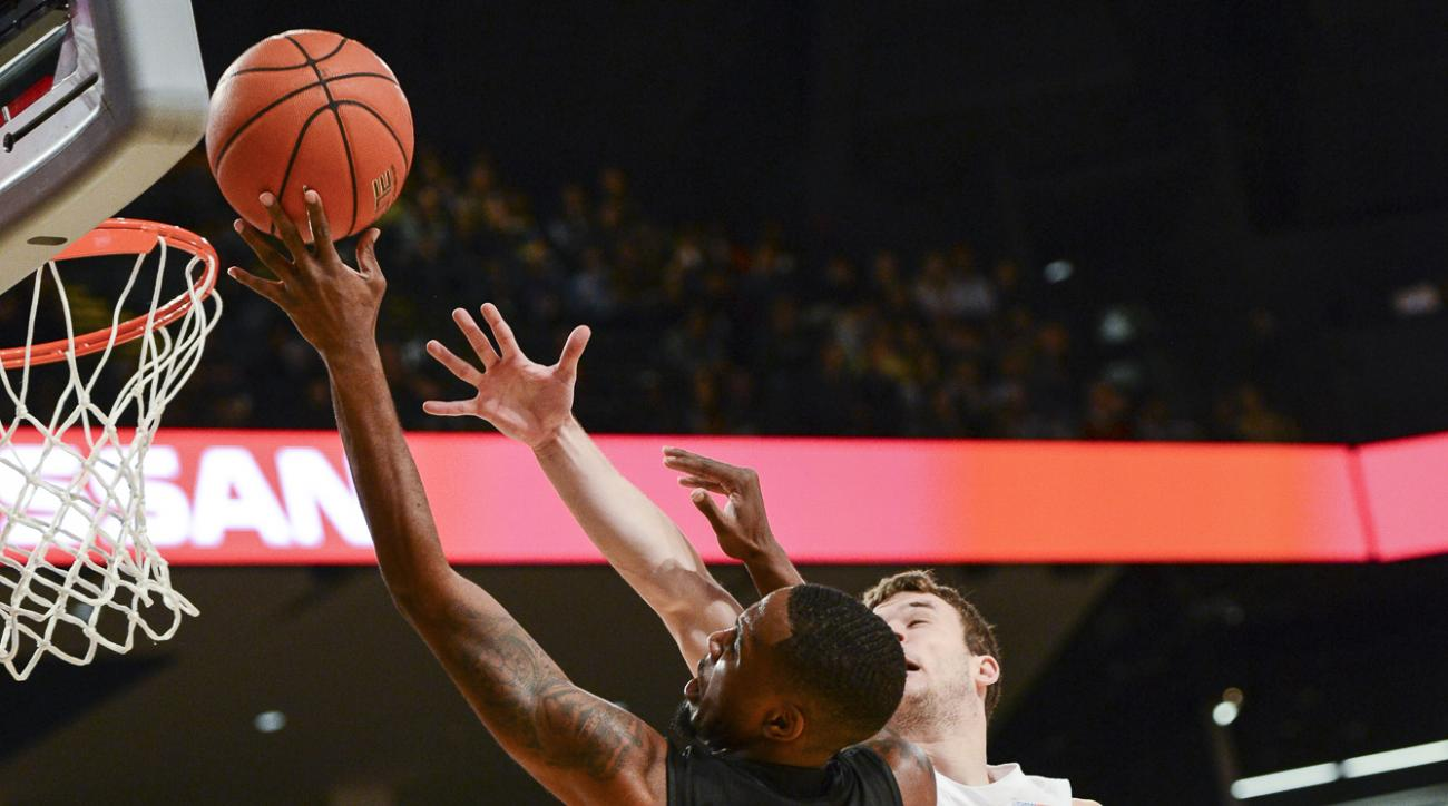 Miami guard Ja'Quan Newton (0) shoots while defended by Georgia Tech guard Travis Jorgenson (10) during the first half of an NCAA college basketball game, Sunday, Feb. 7, 2016, in Atlanta. (AP Photo/Jon Barash)