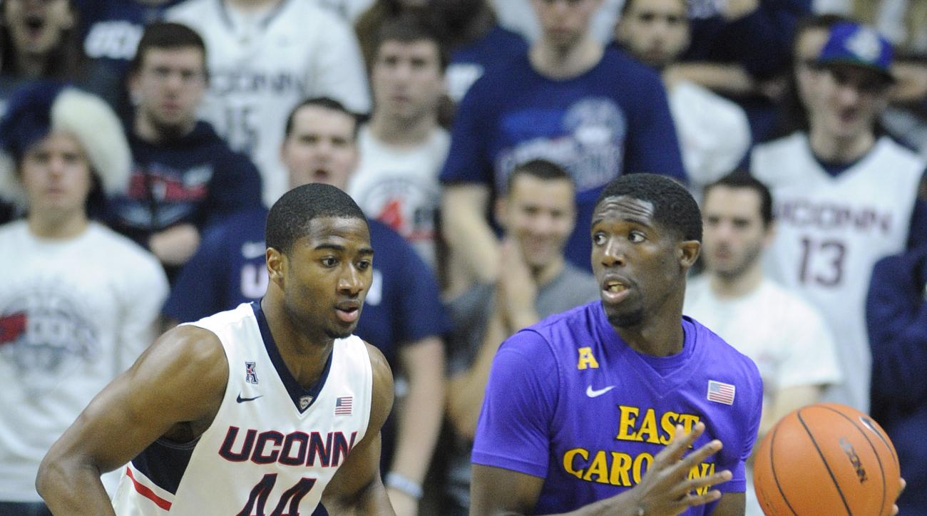 East Carolina's Prince Williams (4) is guarded by Connecticut's Rodney Purvis (44) during the second half of an NCAA college basketball game in Storrs, Conn., on Sunday, Feb. 7, 2016. (AP Photo/Fred Beckham)