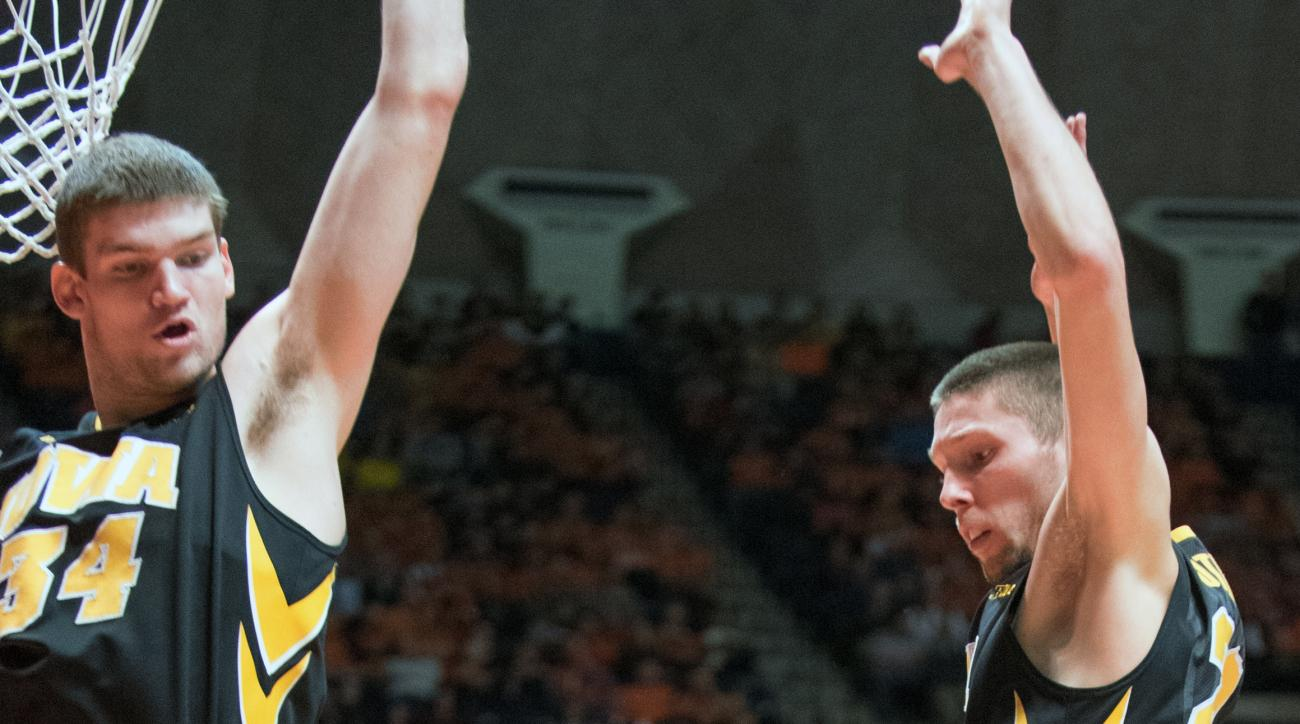 Illinois' Michael Finke (43)  is guarded by Iowa center Adam Woodbury (34) and forward Jarrod Uthoff (20) during an NCAA college basketball game in Champaign, Ill., Sunday, Feb. 7, 2016. (AP Photo/Robin Scholz)