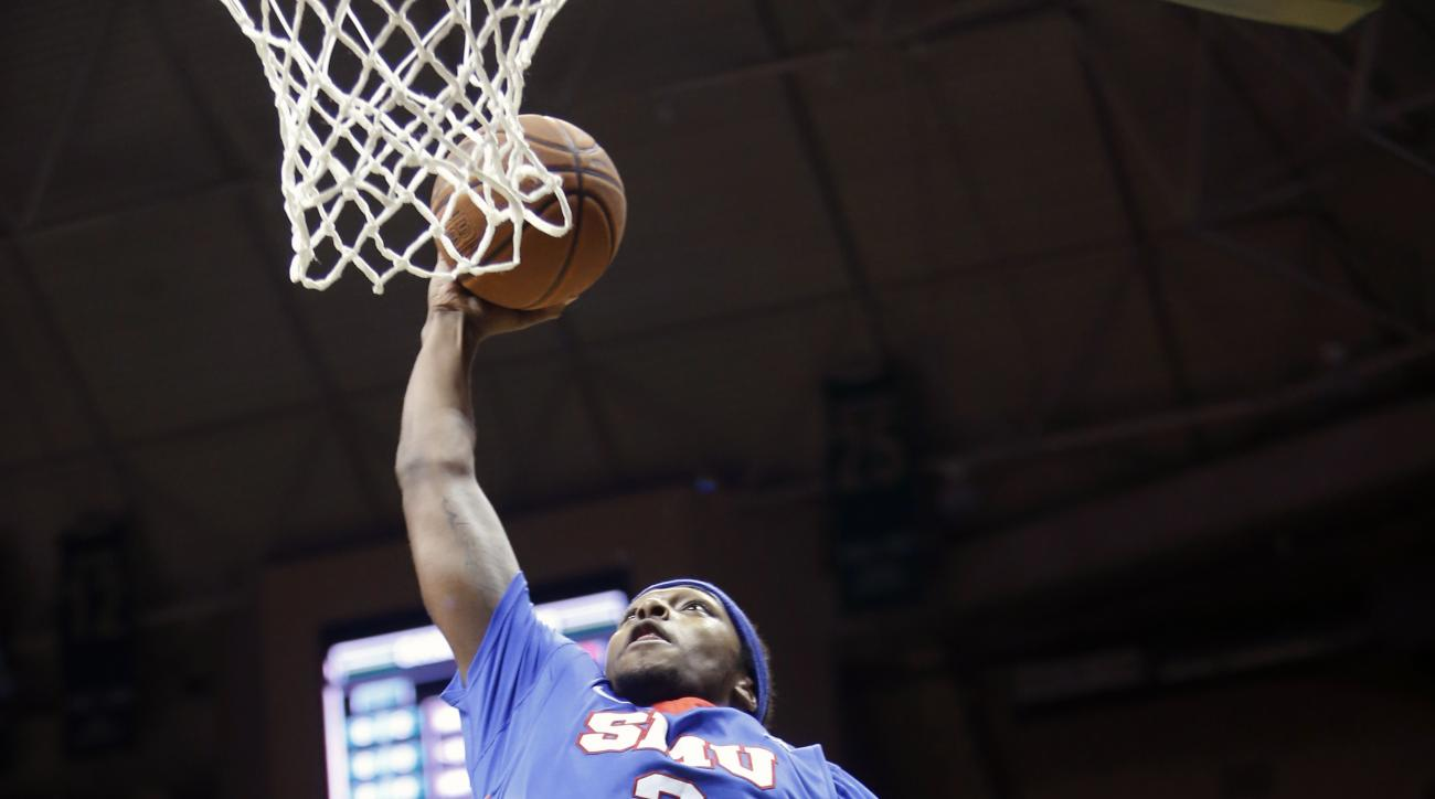 SMU guard Sterling Brown (3) shoots against South Florida center Jaleel Cousins, left, during the first half of an NCAA college basketball game Sunday, Feb. 7, 2016, in Tampa, Fla. (AP Photo/Brian Blanco)