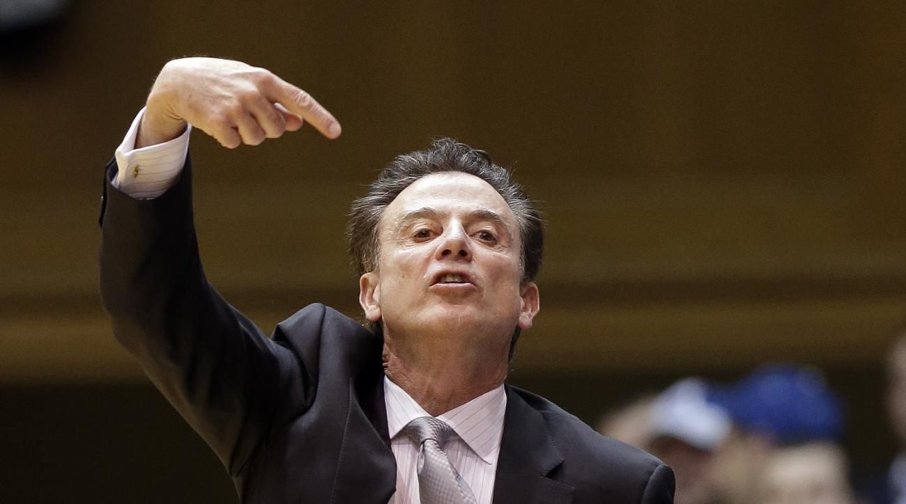 Louisville coach Rick Pitino directs his team during the first half of an NCAA college basketball game against Duke in Durham, N.C., Monday, Feb. 8, 2016. (AP Photo/Gerry Broome)