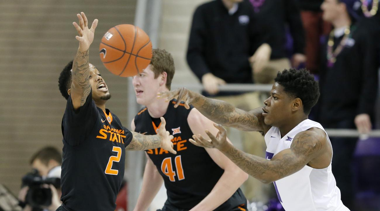 Oklahoma State's Tyree Griffin (2) defends against a pass by TCU's Chauncey Collins, right, in the first half of an NCAA college basketball game, Monday, Feb. 8, 2016, in Fort Worth, Texas. (AP Photo/Tony Gutierrez)