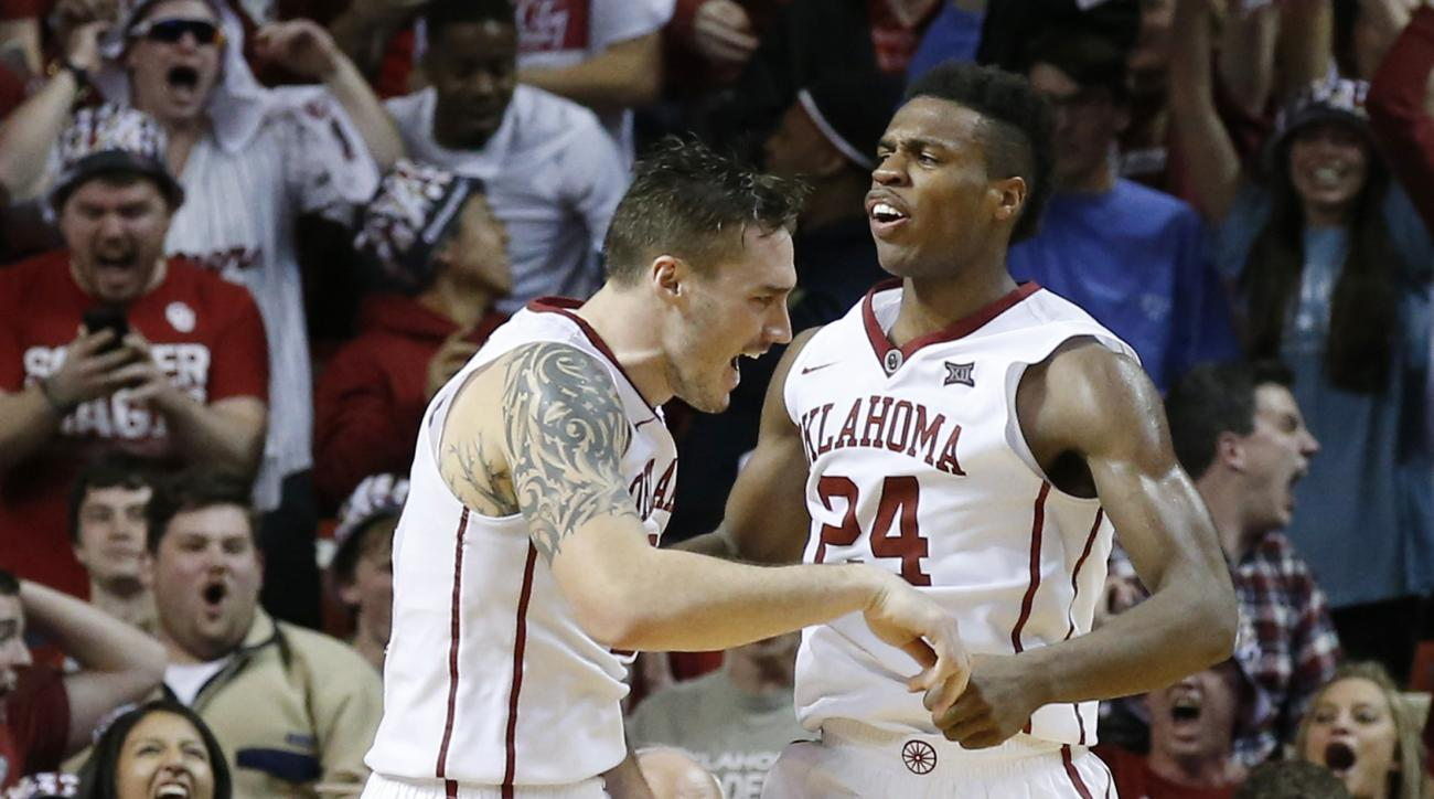 Oklahoma forward Ryan Spangler, left, and guard Buddy Hield (24) celebrate late in the second half of an NCAA college basketball game against Texas in Norman, Okla., Monday, Feb. 8, 2016. Oklahoma won 63-60. (AP Photo/Sue Ogrocki)