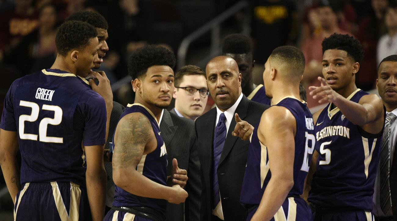 FILE - In this Saturday, Jan. 30, 2016, file photo, Washington head coach Lorenzo Romar, center, talks with his team during a break in play in the first half of an NCAA college basketball game against Southern California in Los Angeles. Whistles have beco