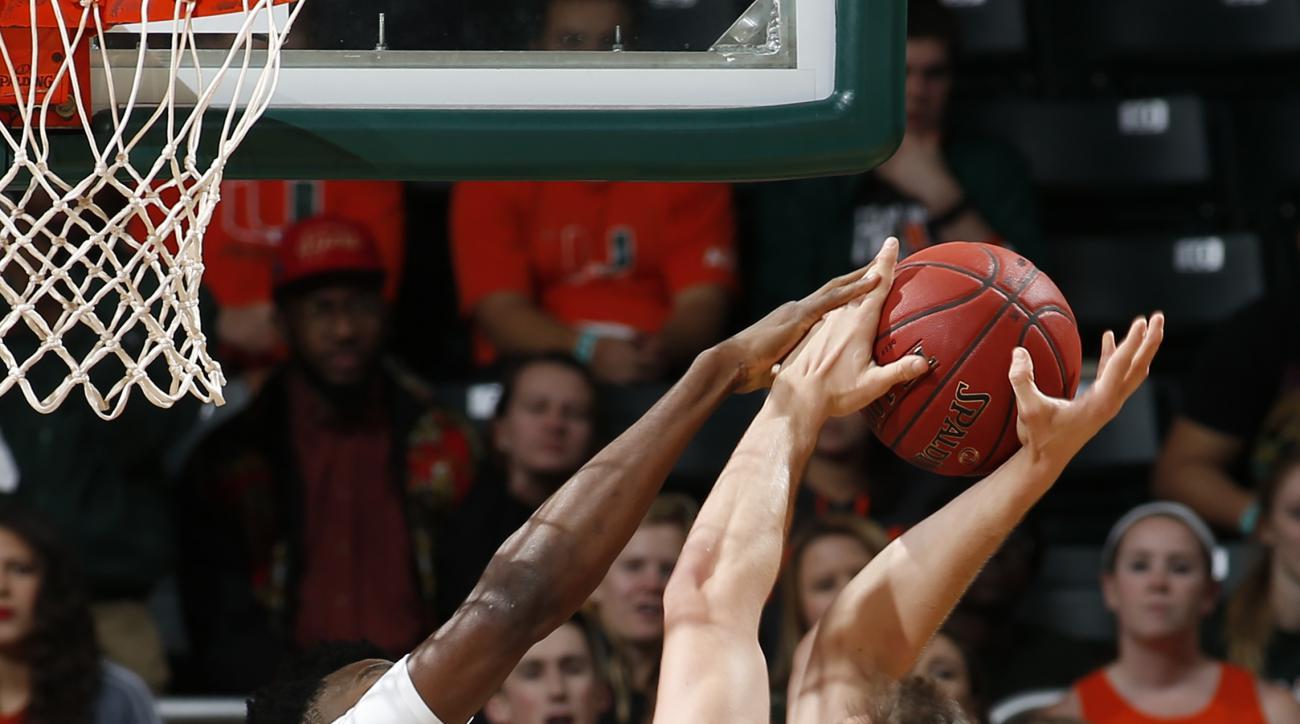 Miami's Ebuka Izundu (15) blocks the shot by Pittsburgh's Rafael Maia (5) during the first half of an NCAA college basketball game in Coral Gables, Fla., Tuesday, Feb. 9, 2016. (AP Photo/Joel Auerbach)