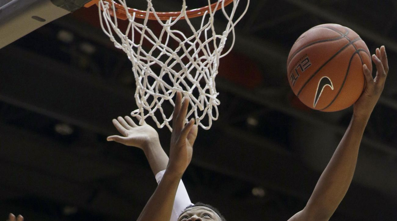 Dayton's Kendall Pollard drives to the basket during the first half of an NCAA college basketball game against Dayton, Tuesday, Feb. 9, 2016 in Dayton, Ohio. (AP Photo/Tony Tribble)