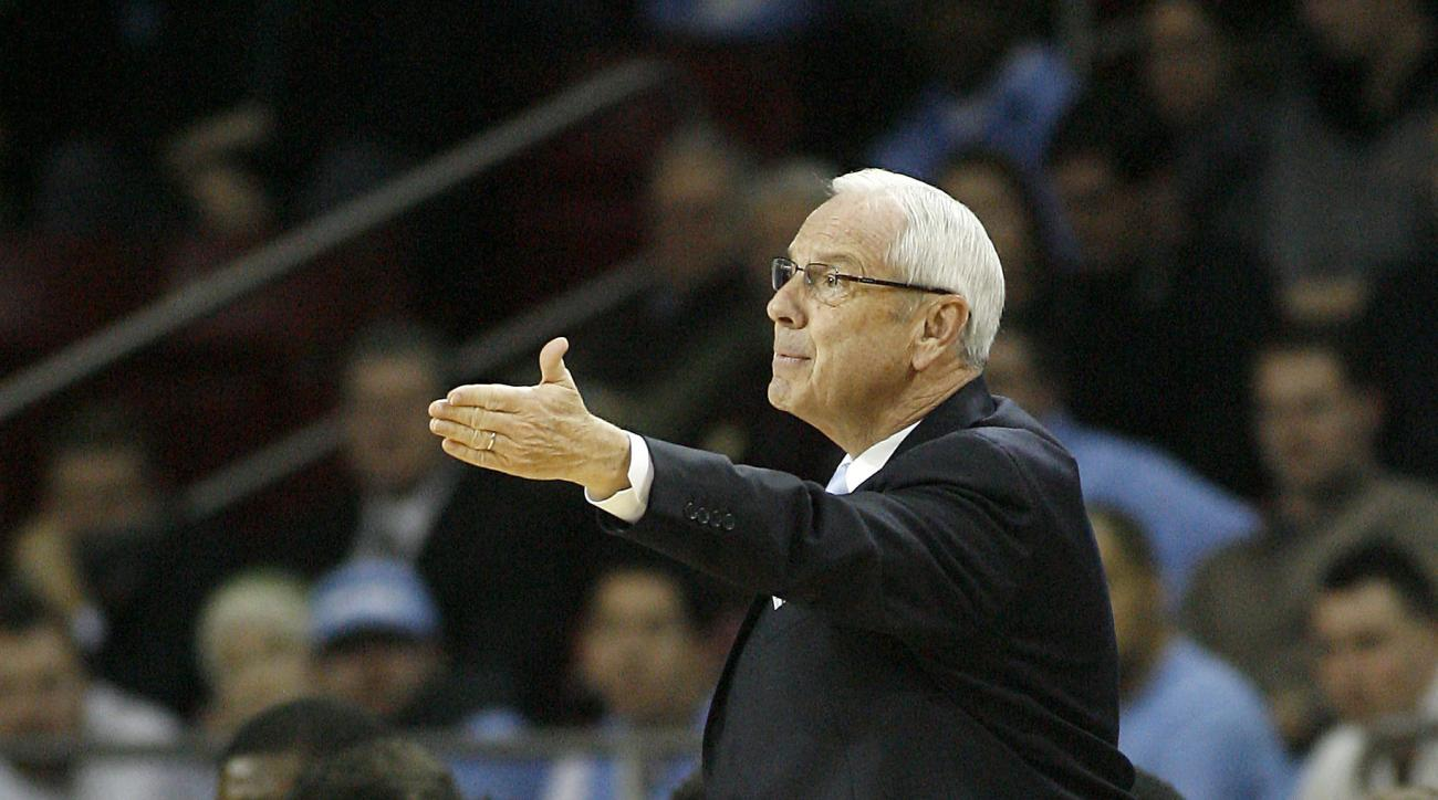 North Carolina head coach Roy Williams questions a call during the first  half of an NCAA college basketball game against Boston College, in Boston, Tuesday, Feb. 9, 2016.  (AP Photo/Stew Milne)