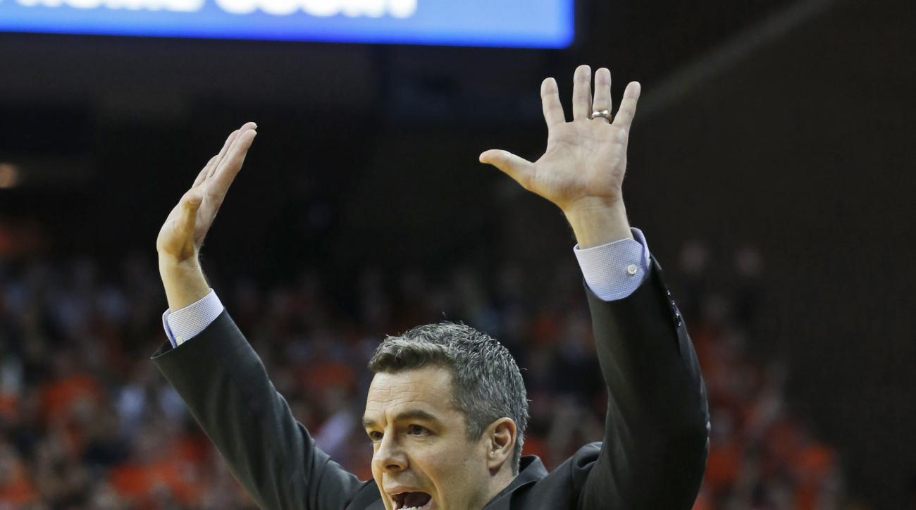 Virginia head coach Tony Bennett reacts to a call during the first half of an NCAA college basketball game against Virginia Tech, in Charlottesville, Va., Tuesday, Feb. 9, 2016.   (AP Photo/Steve Helber)