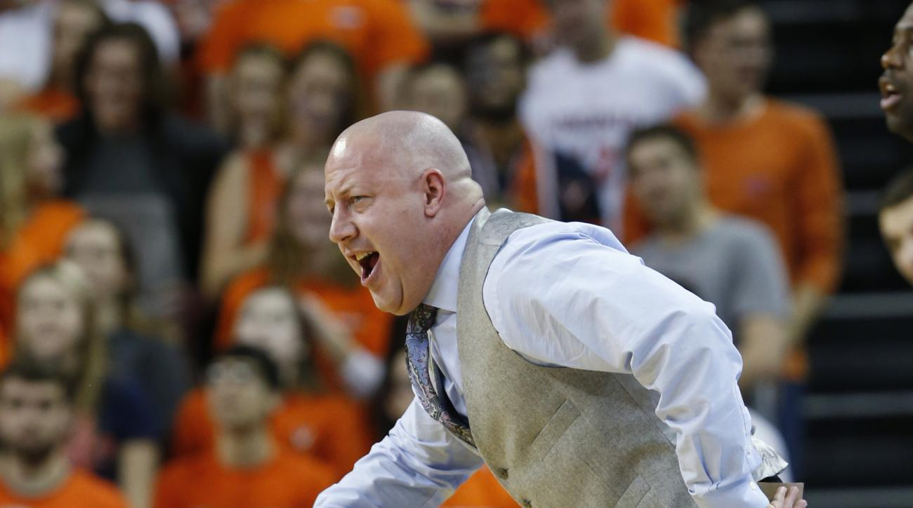 Virginia Tech head basketball coach Buzz Williams directs his team during the first half of an NCAA college basketball game in Charlottesville, Va., Tuesday, Feb. 9, 2016.   (AP Photo/Steve Helber)