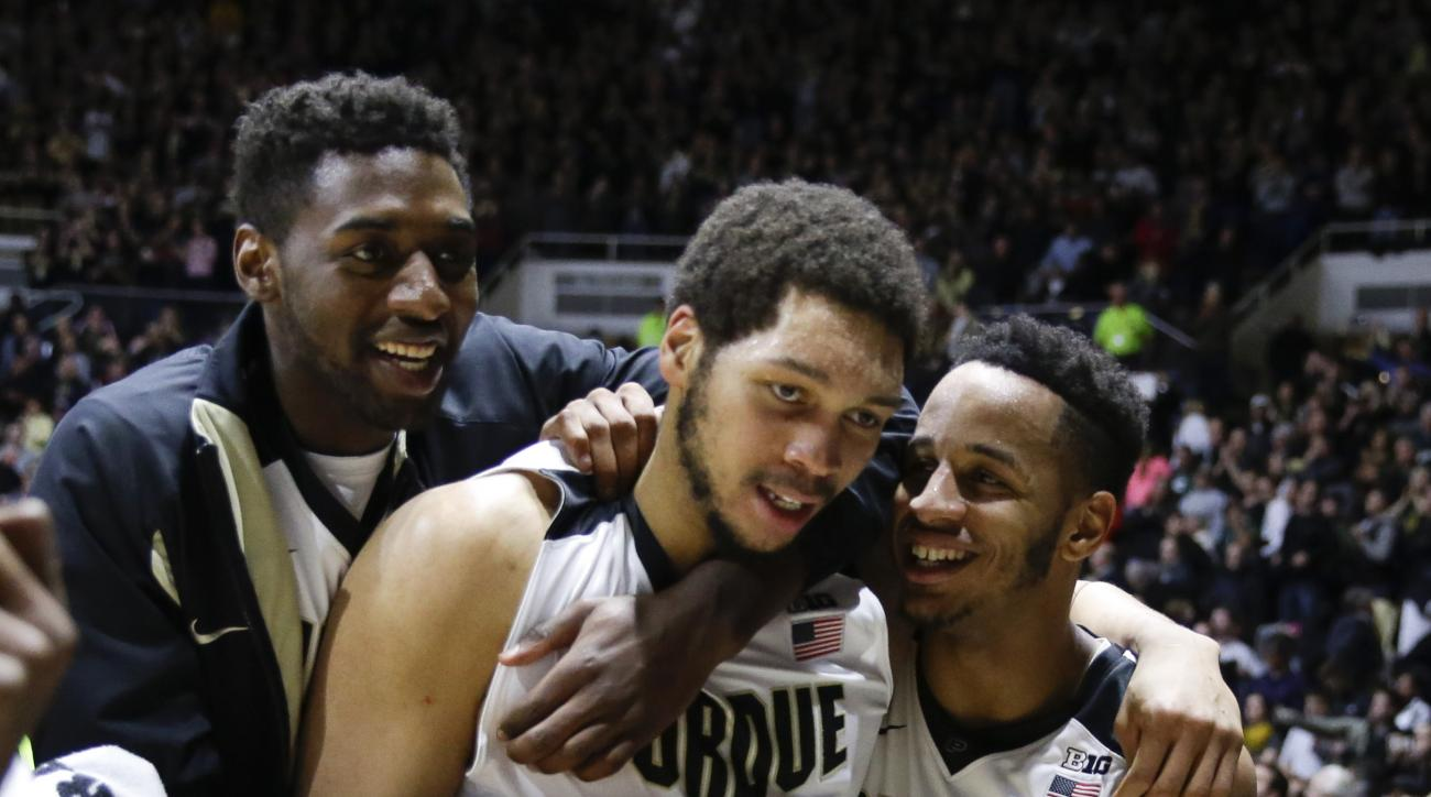 Purdue center A.J. Hammons (20), center, celibates with forward Vince Edwards (12) and forward Jacquil Taylor (23) following an NCAA college basketball game in West Lafayette, Ind., Tuesday, Feb. 9, 2016. Purdue defeated Michigan State 82-81 in overtime.