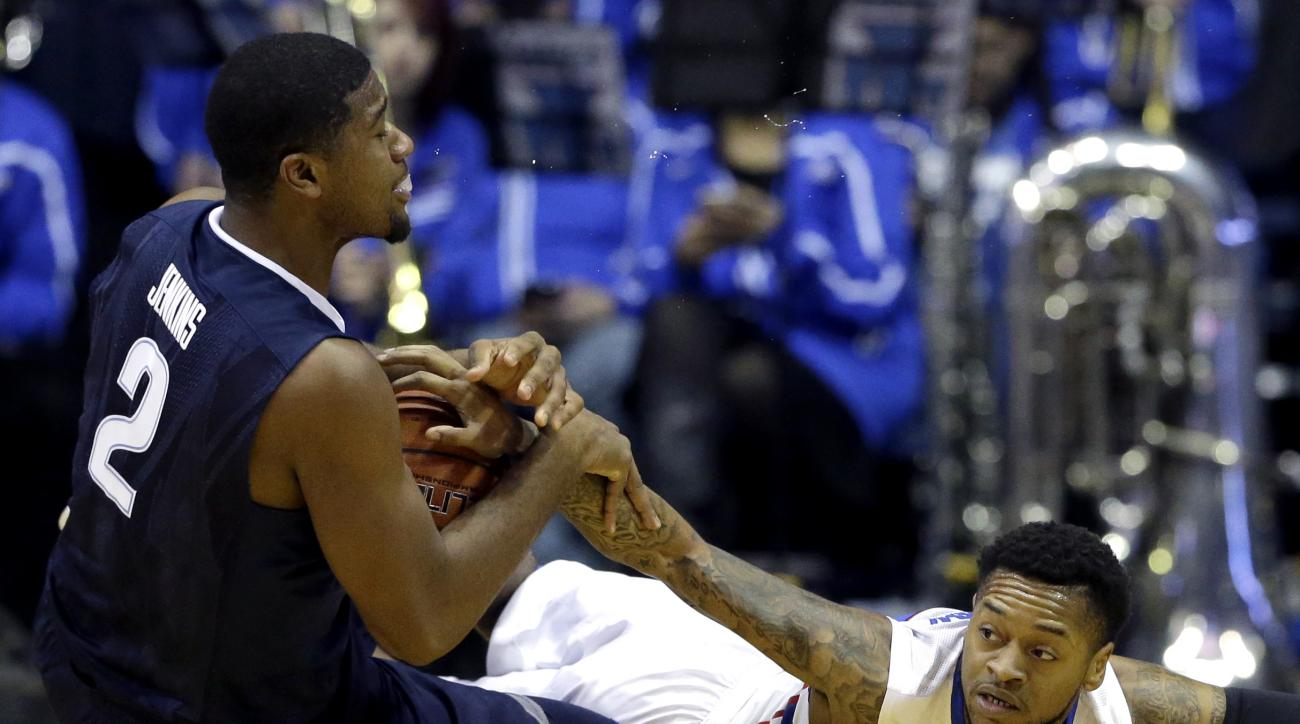 Villanova forward Kris Jenkins, left, battles for a loose ball against DePaul guard Aaron Simpson during the first half of an NCAA college basketball game Tuesday, Feb. 9, 2016, in Rosemont, Ill. (AP Photo/Nam Y. Huh)