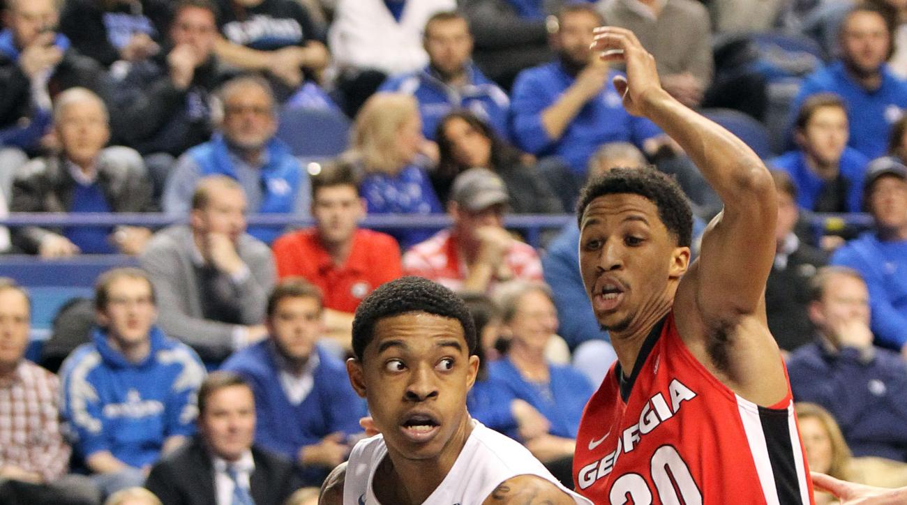 Kentucky's Tyler Ulis, left, drives around Georgia's J.J. Frazier (30) during the first half of an NCAA college basketball game Tuesday, Feb. 9, 2016, in Lexington, Ky. (AP Photo/James Crisp)