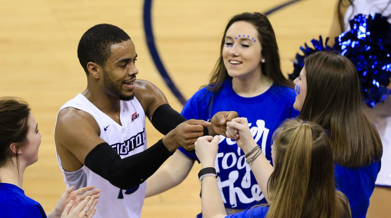 Creighton's Maurice Watson Jr. (10) celebrates with members of the cheering squad following the second half of an NCAA college basketball game against Xavier in Omaha, Neb., Tuesday, Feb. 9, 2016. Watson scored 32 poings in Creighton's win 70-56. (AP Phot