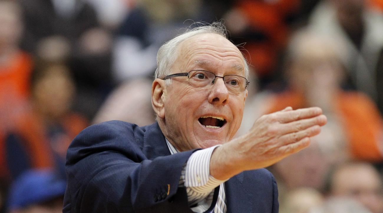 FILE- In this Jan. 30, 2016, file photo, Syracuse head coach Jim Boeheim directs to his players in the first half of an NCAA college basketball game against Georgia Tech in Syracuse, N.Y. Boeheim was suspended earlier this season by the NCAA as part of pe
