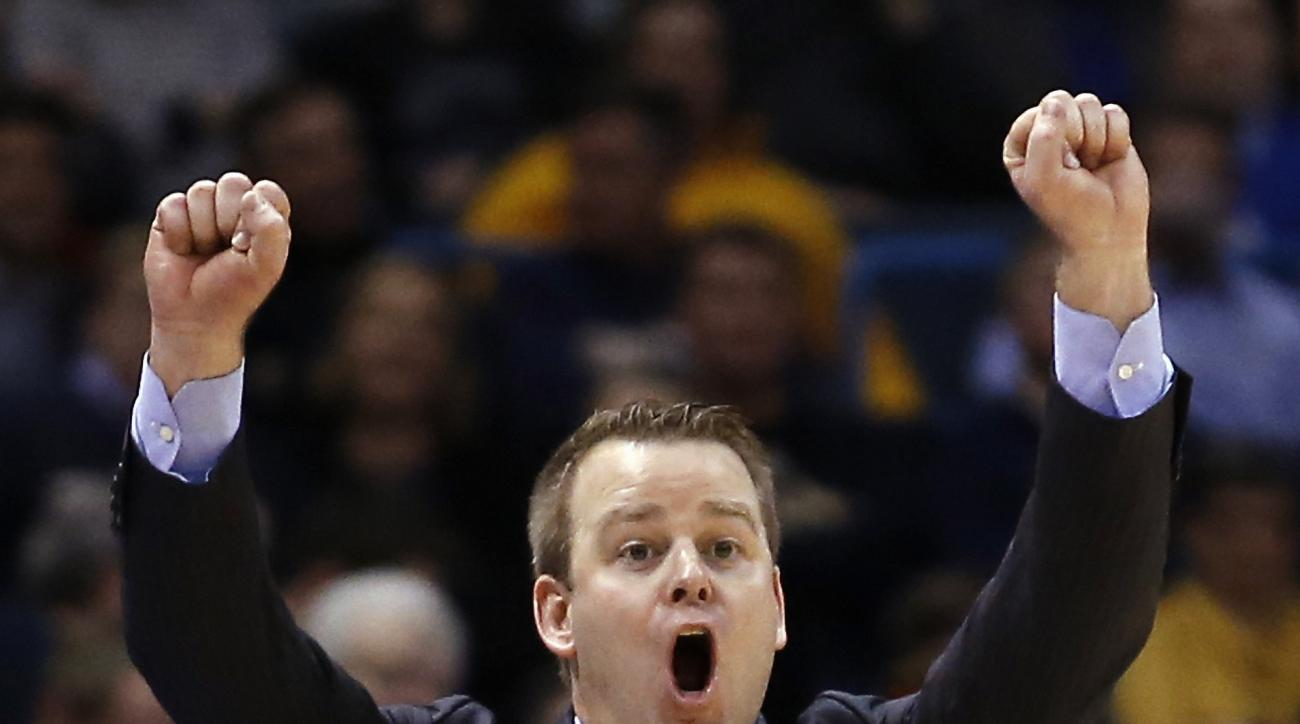 Marquette head coach Steve Wojciechowski signals to his players during the first half of an NCAA college basketball game against Providence Wednesday, Feb. 10, 2016, in Milwaukee. (AP Photo/Morry Gash)