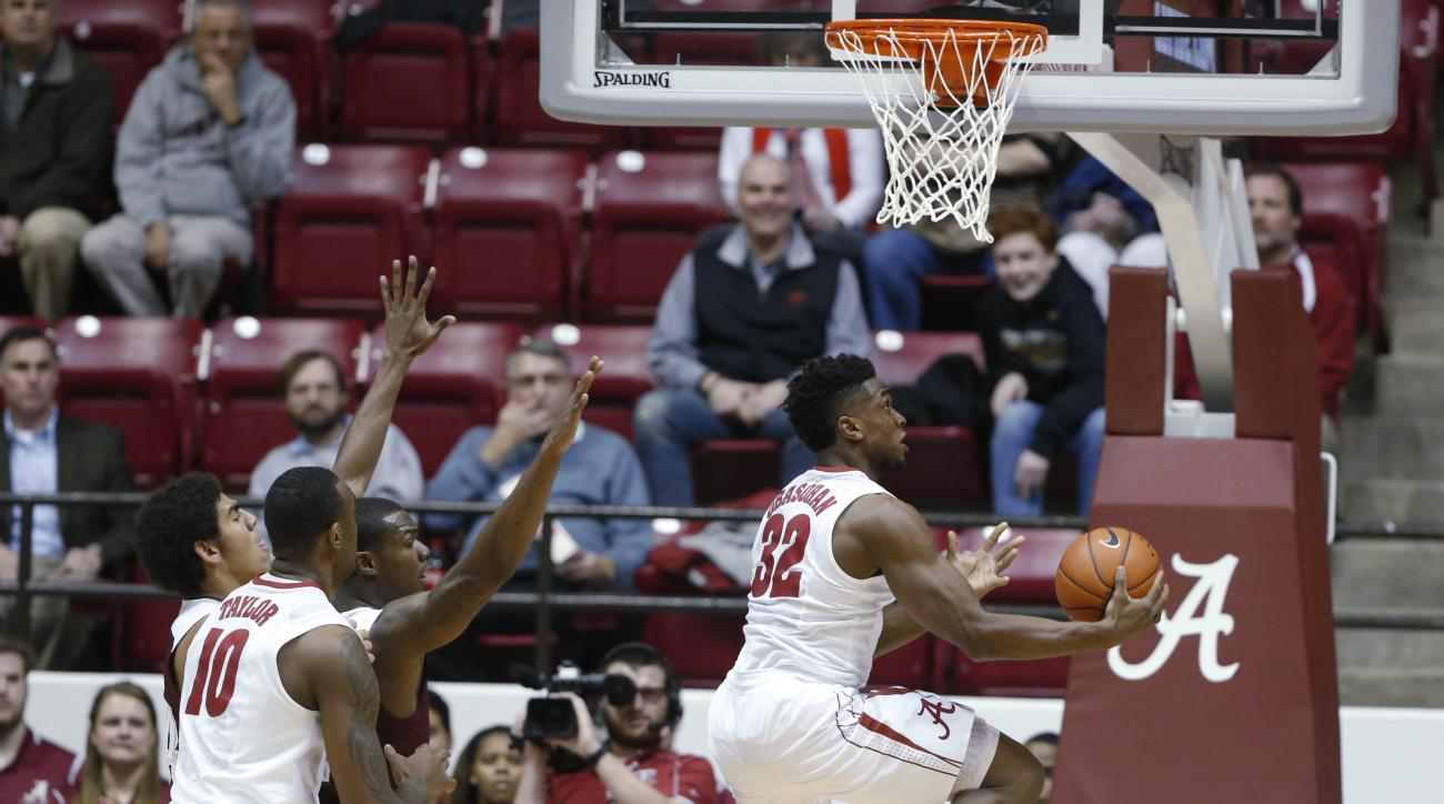 Alabama guard Retin Obasohan (32) scores against Texas A&M during the first half of an NCAA college basketball game Wednesday, Feb. 10, 2016, in Tuscaloosa, Ala. (AP Photo/Brynn Anderson)