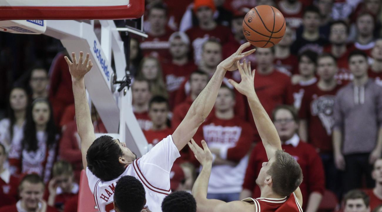 Nebraska's Jake Hammond (24) blocks a shot by Wisconsin's Alex Illikainen (25) during the first half of an NCAA college basketball game Wednesday, Feb. 10, 2016, in Madison, Wis. (AP Photo/Andy Manis)