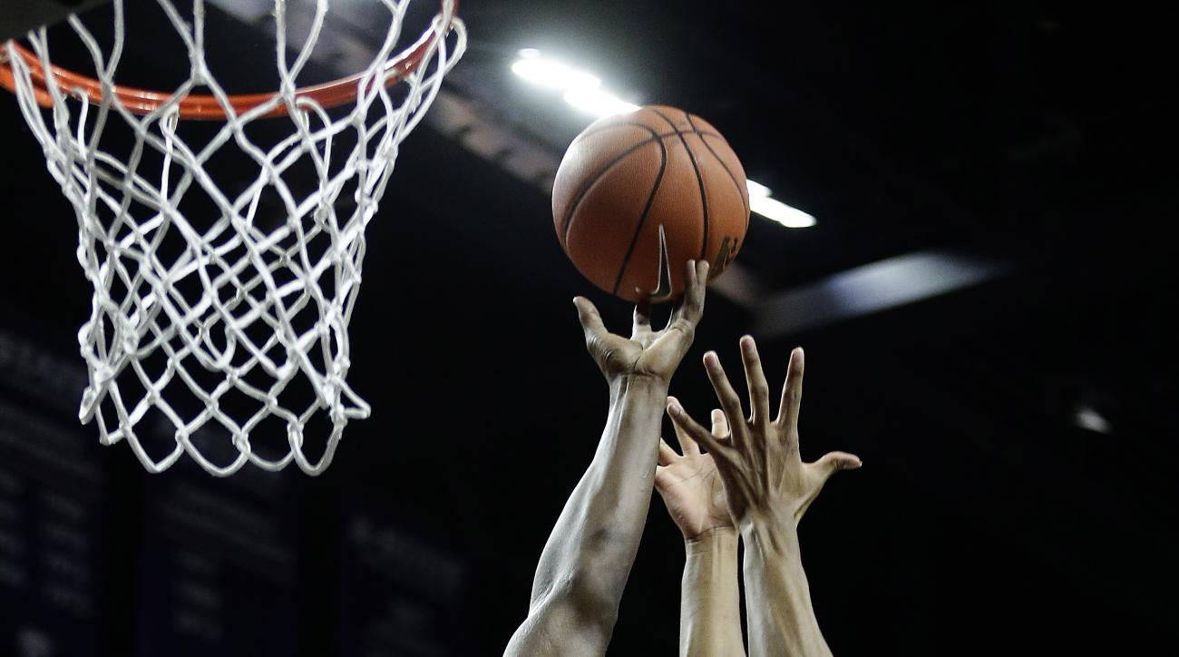 Baylor's Terry Maston (31) and Kansas State's D.J. Johnson (4) compete for a rebound during the first half of an NCAA college basketball game Wednesday, Feb. 10, 2016, in Manhattan, Kan. (AP Photo/Charlie Riedel)