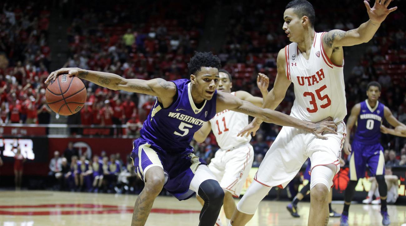 Washington guard Dejounte Murray (5) drives as Utah forward Kyle Kuzma (35) defends in the first half during an NCAA college basketball game Wednesday, Feb. 10, 2016, in Salt Lake City. (AP Photo/Rick Bowmer)
