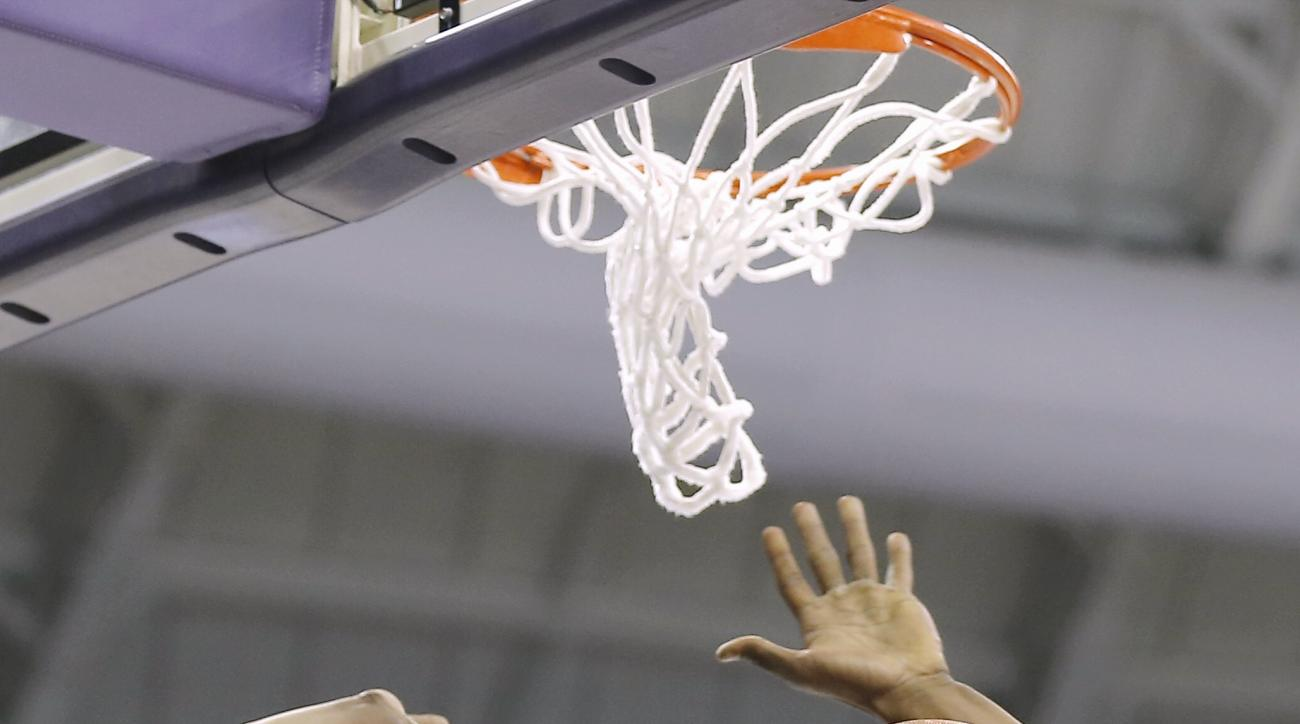 CORRECTS SPELLING TO WEST VIRGINIA West Virginia forward Jonathan Holton dunks during the first half of an NCAA college basketball game against TCU Monday, Jan. 4, 2016, in Fort Worth, Texas. (AP Photo/Brandon Wade)