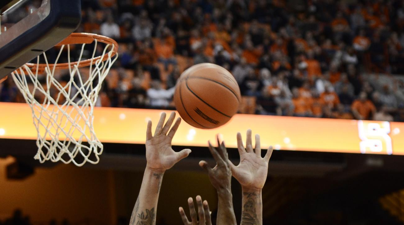 Florida State's Malik Beasley, right, has his shot blocked by Syracuse's Dajuan Coleman during the first half of an NCAA college basketball game in Syracuse, N.Y., Thursday, Feb. 11, 2016. (AP Photo/Heather Ainsworth)
