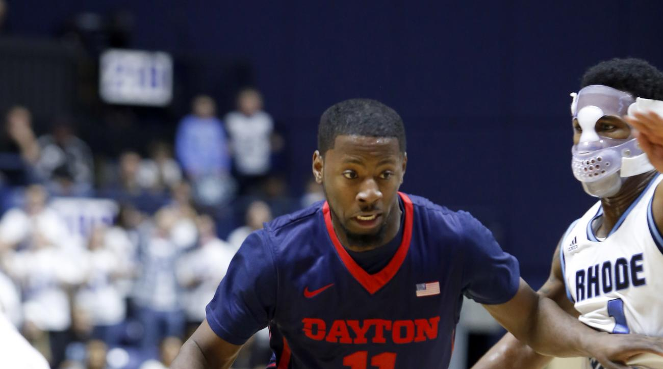 Dayton's Scoochie Smith (11) drives past Rhode Island's Jarvis Garrett (1) during the second half of an NCAA college basketball game in Kingston, R.I., on Friday, Feb. 12, 2016. (AP Photo/Joe Giblin)