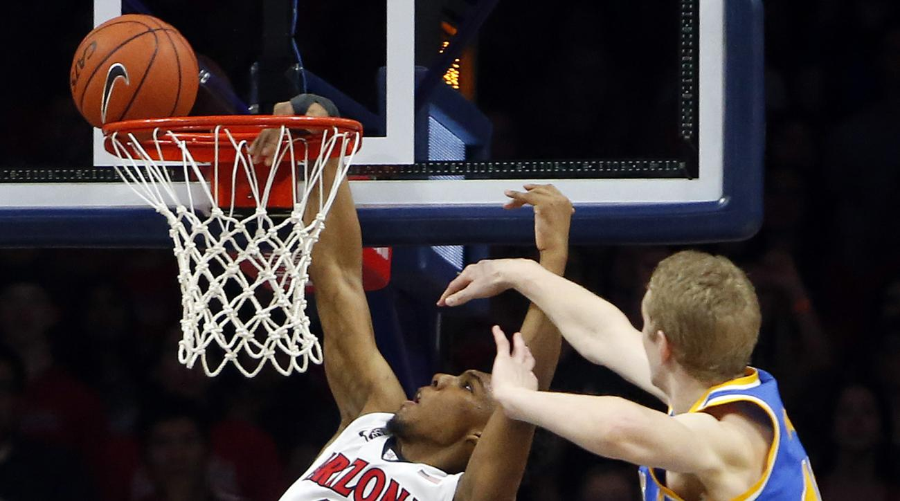 Arizona guard Allonzo Trier (11) is fouled by UCLA center Thomas Welsh during the first half of an NCAA college basketball game Friday, Feb 12, 2016, in Tucson, Ariz. (AP Photo/Rick Scuteri)