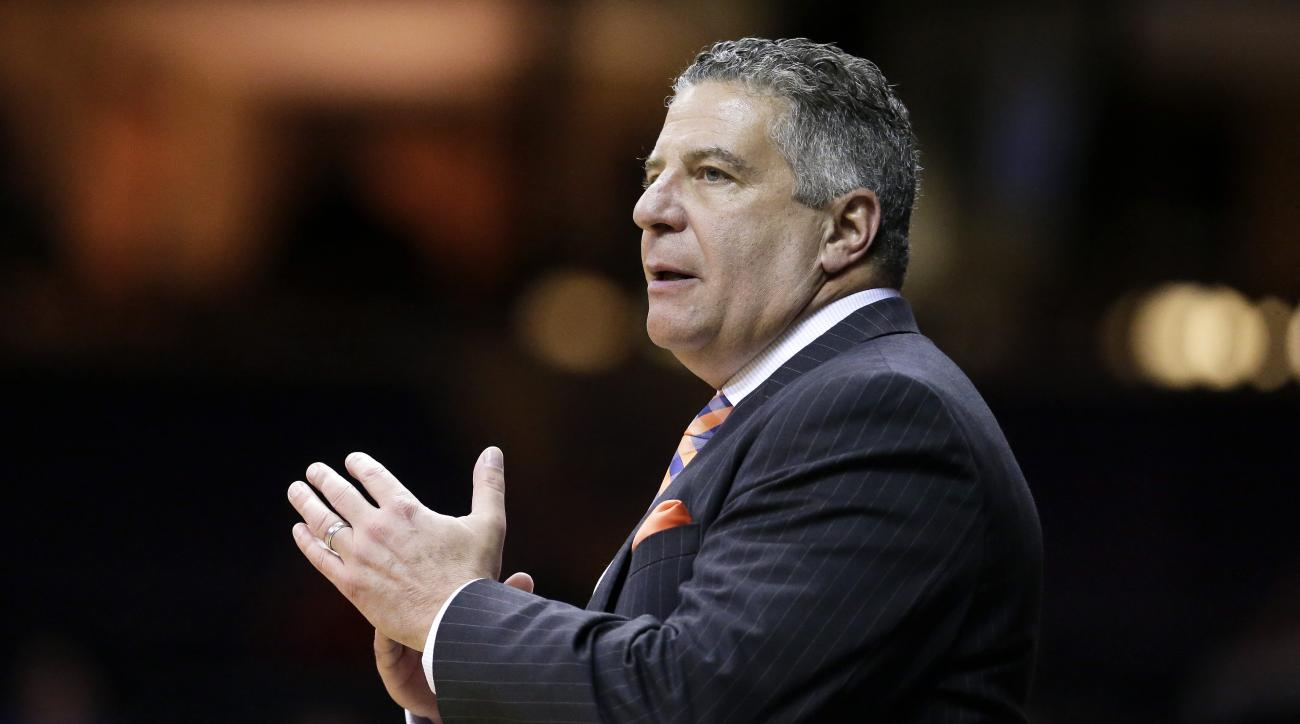 FILE - In this Jan. 12, 2016, file photo, Auburn coach Bruce Pearl calls a timeout during the team's NCAA college basketball game against Vanderbilt in Nashville, Tenn. Coaches have spent this season trying to adjust to a new NCAA rule that prevents them