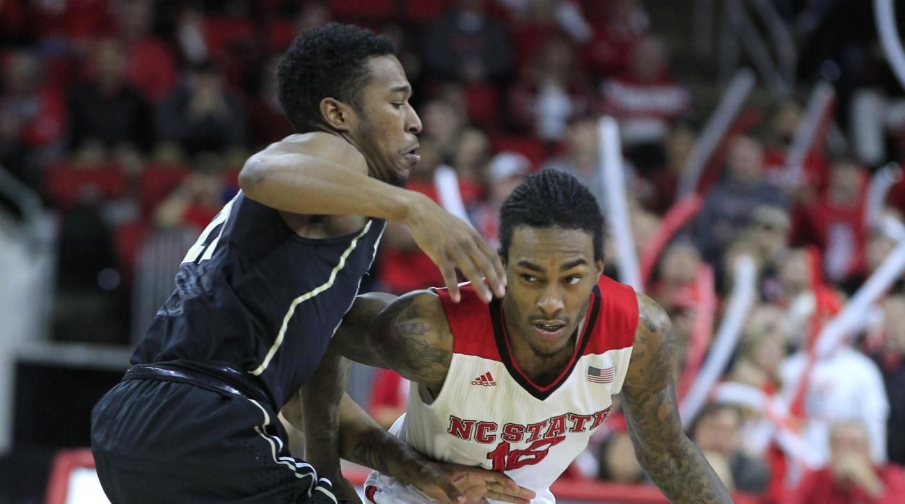 """North Carolina State's Anthony """"Cat"""" Barber, right, drives around Wake Forest's Bryant Crawford during the first half of an NCAA college basketball game, Saturday, Feb. 13, 2016, in Raleigh, N.C. (Ethan Hyman/The News & Observer via AP) MANDATORY CREDIT"""