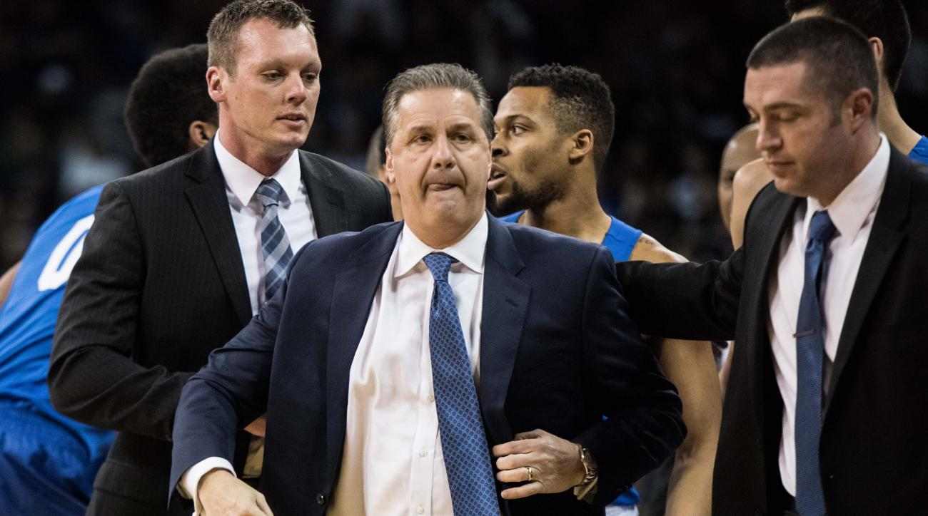 Kentucky head coach John Calipari leaves the court after receiving two technical fouls and getting ejected during the first half of an NCAA college basketball game against South Carolina Saturday, Feb. 13, 2016, in Columbia, S.C. Kentucky defeated South C