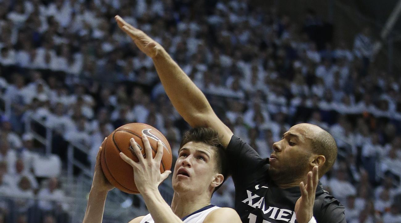 Butler's Kellen Dunham (24) shoots against Xavier's Myles Davis (15) during the first half of an NCAA college basketball game Saturday, Feb. 13, 2016, in Indianapolis. (AP Photo/Darron Cummings)