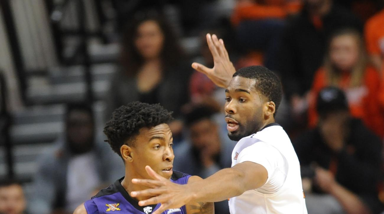 Kansas State guard Wesley Iwundu, left, is guarded by Oklahoma State guard Tavarius Shine in the second half of an NCAA college basketball game in Stillwater, Okla., Saturday, Feb. 13, 2016. (AP Photo/Brody Schmidt)