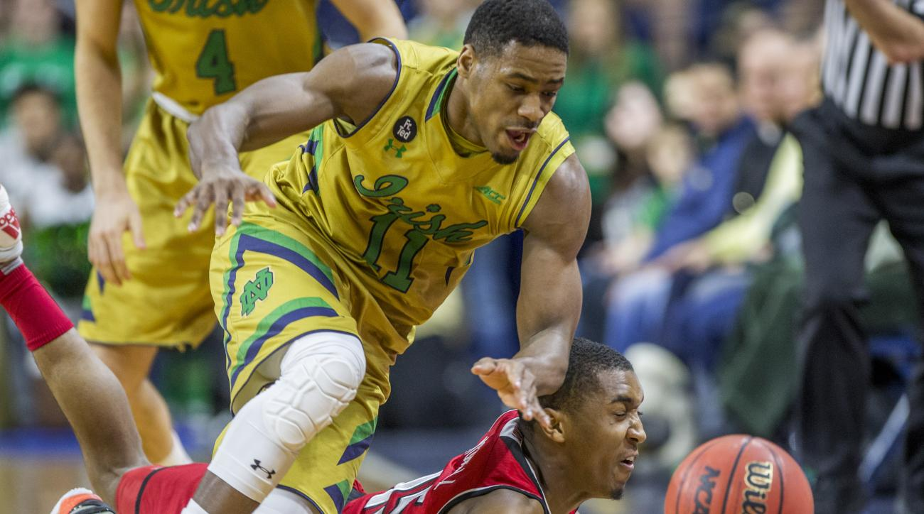 Notre Dame's Demetrius Jackson, top, competes for a loose ball with Louisville's DonovanMitchell (45) during the first half of an NCAA college basketball game, Saturday, Feb. 13, 2016, in South Bend, Ind. (AP Photo/Robert Franklin)