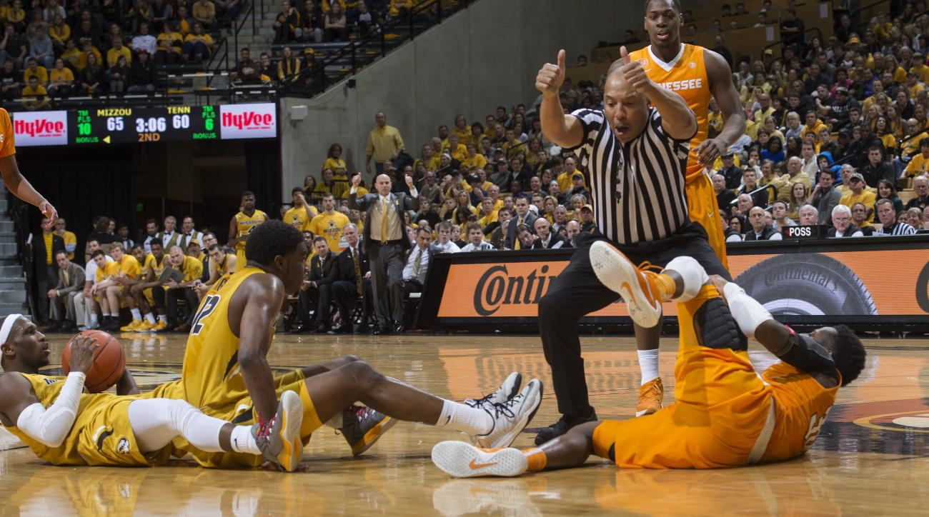 Referee Glenn Tuitt calls a jump ball as Missouri and Tennessee players lay on the court during the second half of an NCAA college basketball game, Saturday, Feb. 13, 2016, in Columbia, Mo. Missouri won the game 75-64. (AP Photo/L.G. Patterson)