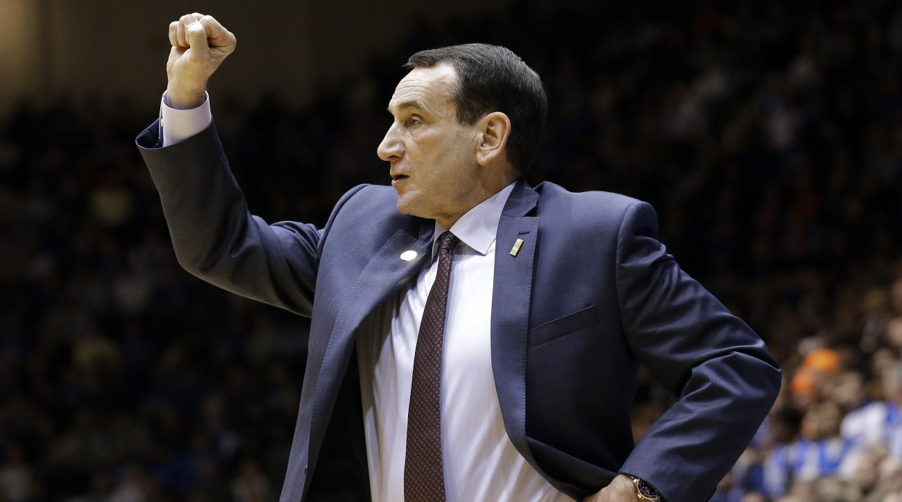Duke head coach Mike Krzyzewski gestures during the second half of an NCAA college basketball game against Virginia in Durham, N.C., Saturday, Feb. 13, 2016. Duke won 63-62. (AP Photo/Gerry Broome)