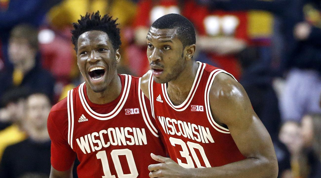 Wisconsin forward Nigel Hayes, left, reacts after teammate Vitto Brown (30) scored during the second half against Maryland in an NCAA college basketball game Saturday, Feb. 13, 2016, in College Park, Md. Wisconsin won 70-57. (AP Photo/Patrick Semansky)